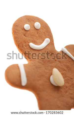 smiling isolated gingerbread Lebkuchen man with almond - stock photo