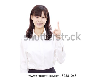 Smiling japanese business woman rise hand and pointing copy space - stock photo