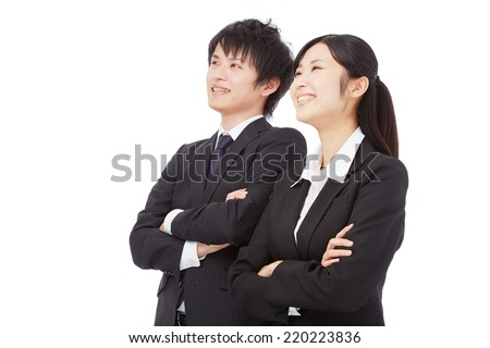 smiling Japanese businesswoman and businessman