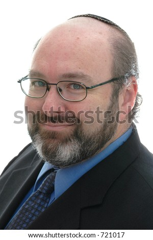 smiling jewish business man in yarmulke , with glasses - stock photo