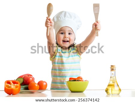 Smiling kid cook with ladle and kitchen spatula , isolated on white - stock photo