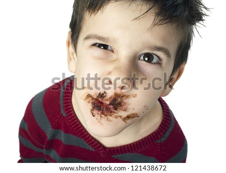 Smiling kid eating chocolate. Smeared stained with chocolate lips. White isolated