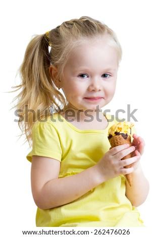 smiling kid girl eating ice cream isolated - stock photo