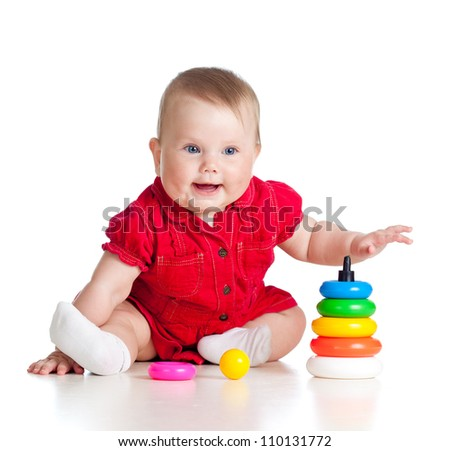 smiling kid girl playing with toy isolated on white background