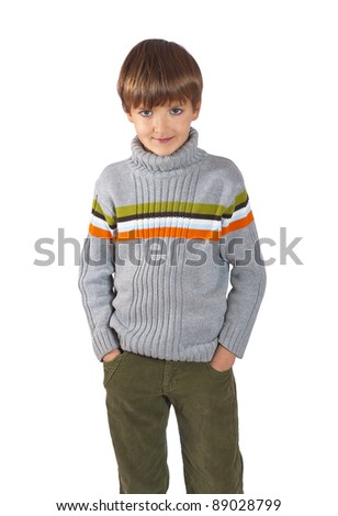 Smiling kid in red cap with Christmas lantern - stock photo