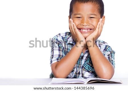 Smiling kid studying isolated on white background - stock photo