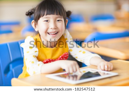 smiling kid using tablet  or ipad - stock photo
