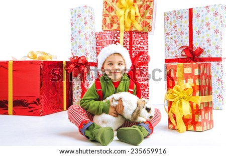 Smiling kid with christmas gifts - stock photo