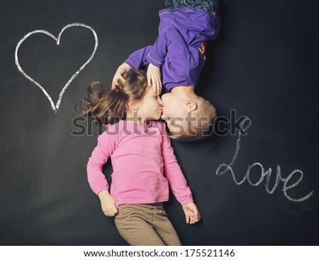Smiling kids on a blackboard background - stock photo