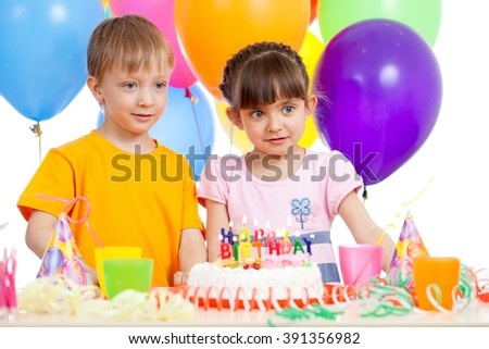 Smiling kids with birthday cake and color ballons - stock photo