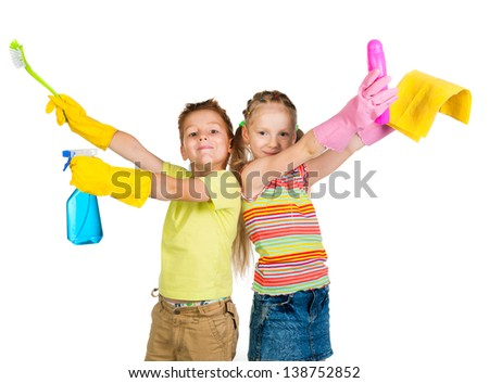 smiling kids with detergents on white background - stock photo