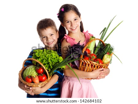 Smiling kids with fresh vegetables in baskets, isolated on white - stock photo