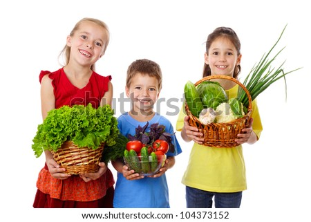 Smiling kids with fresh vegetables in hands, isolated on white - stock photo