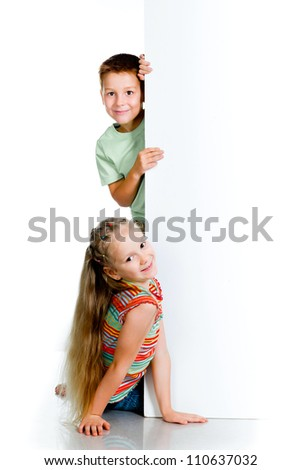 smiling kids with white board - stock photo