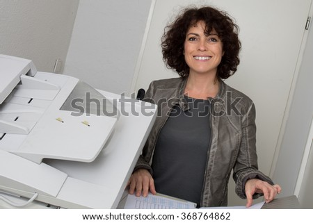 Smiling lady , girl, copying documents on the copy machine isolated - stock photo