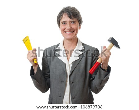 smiling lady holding tools on white background - stock photo