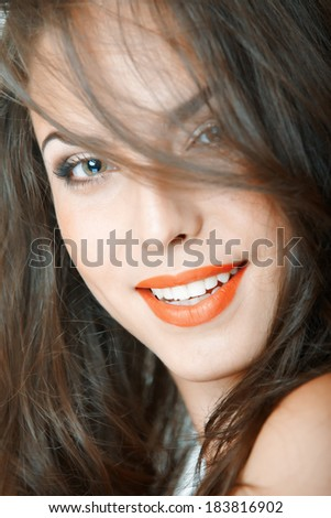 Smiling lady in a studio. Vertical photo