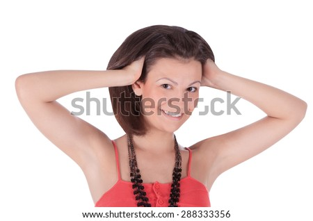 Smiling latino female in red dress posing over white - stock photo