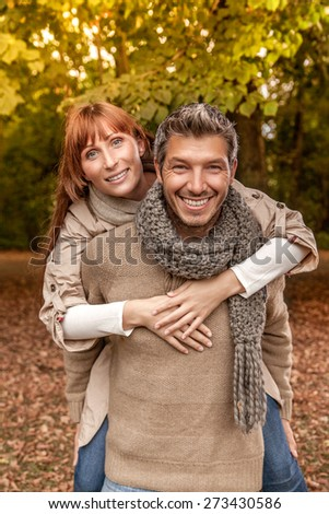 smiling laughing brown autumn couple - stock photo