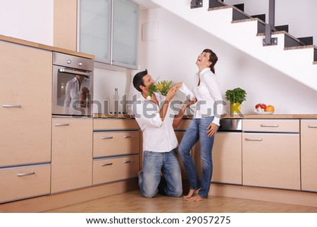 Smiling laughing pair of man and girl at home celebrating - stock photo