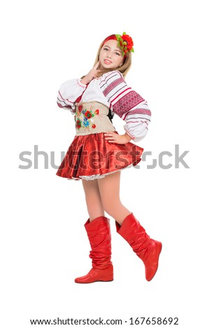 Smiling little blonde wearing Ukrainian national clothes. Isolated on white