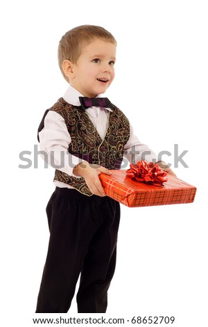 Smiling little boy gives a red gift box, isolated on white - stock photo