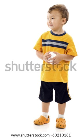 Smiling little boy holding a baseball and looking at the copyspace