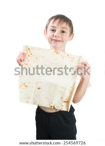 Smiling little boy holding a flat bread on a white background - stock photo