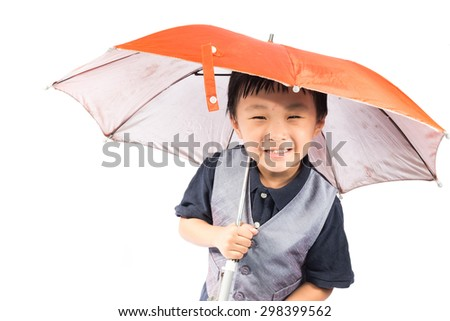 Smiling little boy holding colored umbrella, isolated on white