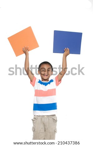 Smiling little boy holding empty two board - stock photo