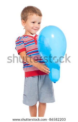 Smiling little boy holding the blue balloon, isolated on white