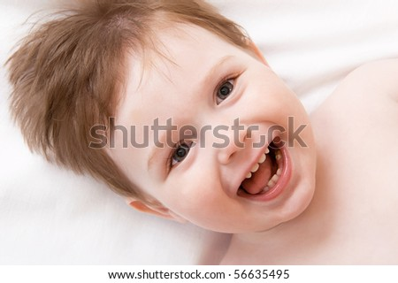 Smiling little boy in a bed