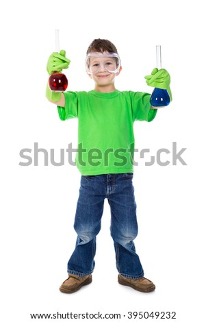 Smiling little boy in protective glasses holding a two chemical flask, isolated on white