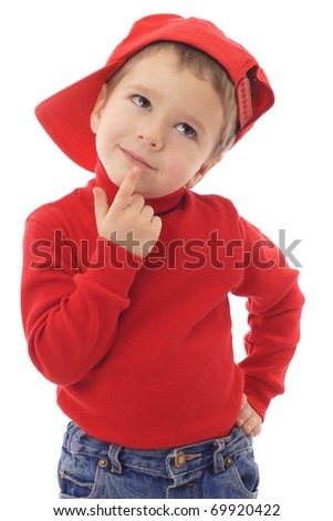 Smiling little boy in red hat thinking about, isolated on white - stock photo