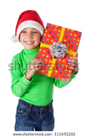 Smiling little boy in Santa's hat with red gift box, isolated on white