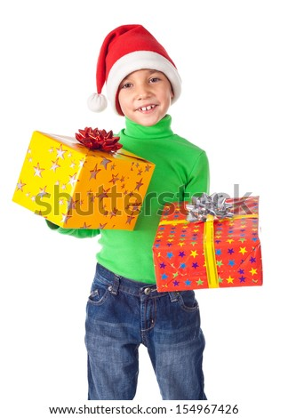 Smiling little boy in Santa's hat with two gift boxes in hands, isolated on white