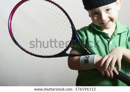 Smiling Little Boy Playing Tennis. Sport Children. Child with Tennis Racket - stock photo