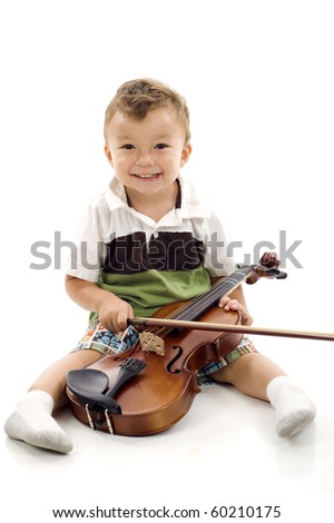 Smiling little boy playing the violin on white background
