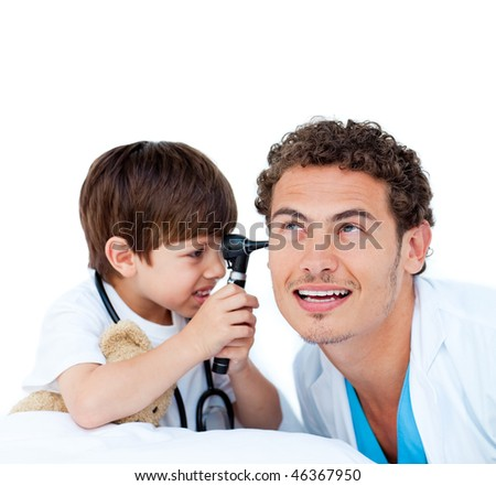 Smiling little boy playing with the doctor against a white background - stock photo