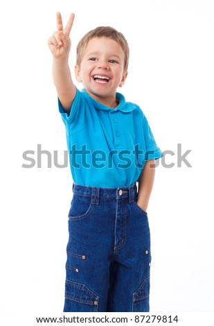 Smiling little boy showing victory gesture, isolated on white
