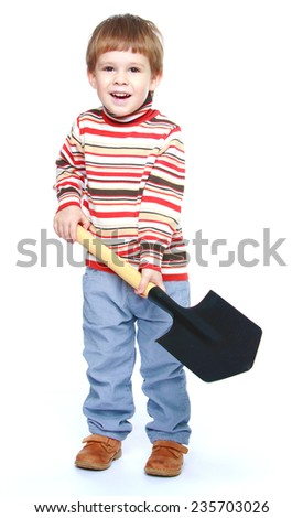 Smiling little boy with a shovel in his hands.White background, isolated photo. - stock photo