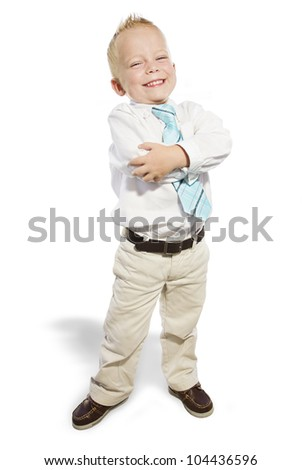 Smiling Little Businessman looking confident - stock photo