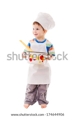Smiling little cook standing with ladle and pan, isolated on white - stock photo