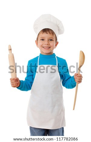 Smiling little cook with ladle and rolling pin, isolated on white - stock photo