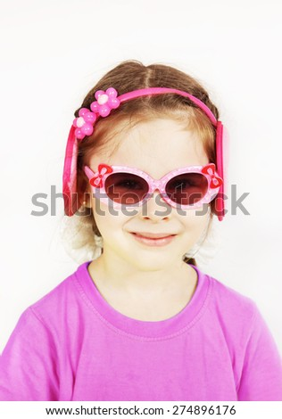 Smiling little cute girl wearing pink sunglasses - stock photo