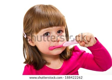 Smiling little girl brushing teeth  - stock photo
