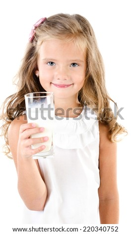 Smiling little girl drinking milk isolated on a white background - stock photo