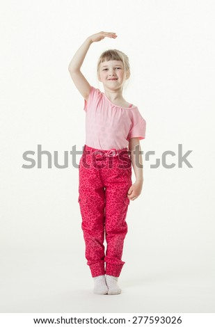 Smiling little girl growing up, white background - stock photo