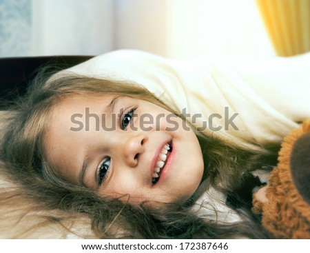 smiling little girl in morning - stock photo