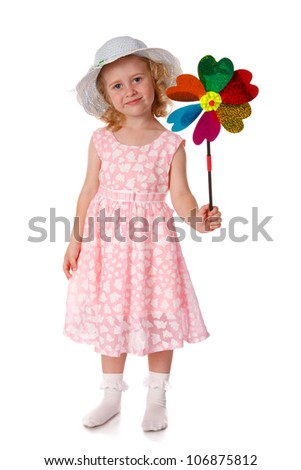 Smiling little girl in white hat with windmill, isolated on white